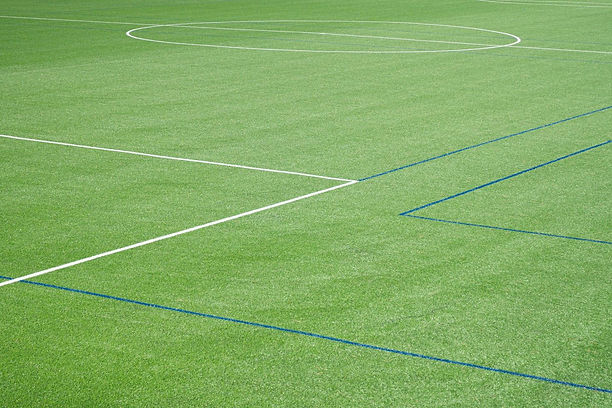 background-of-soccer-field-with-artifici