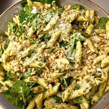 Penne pasta with pesto dressing