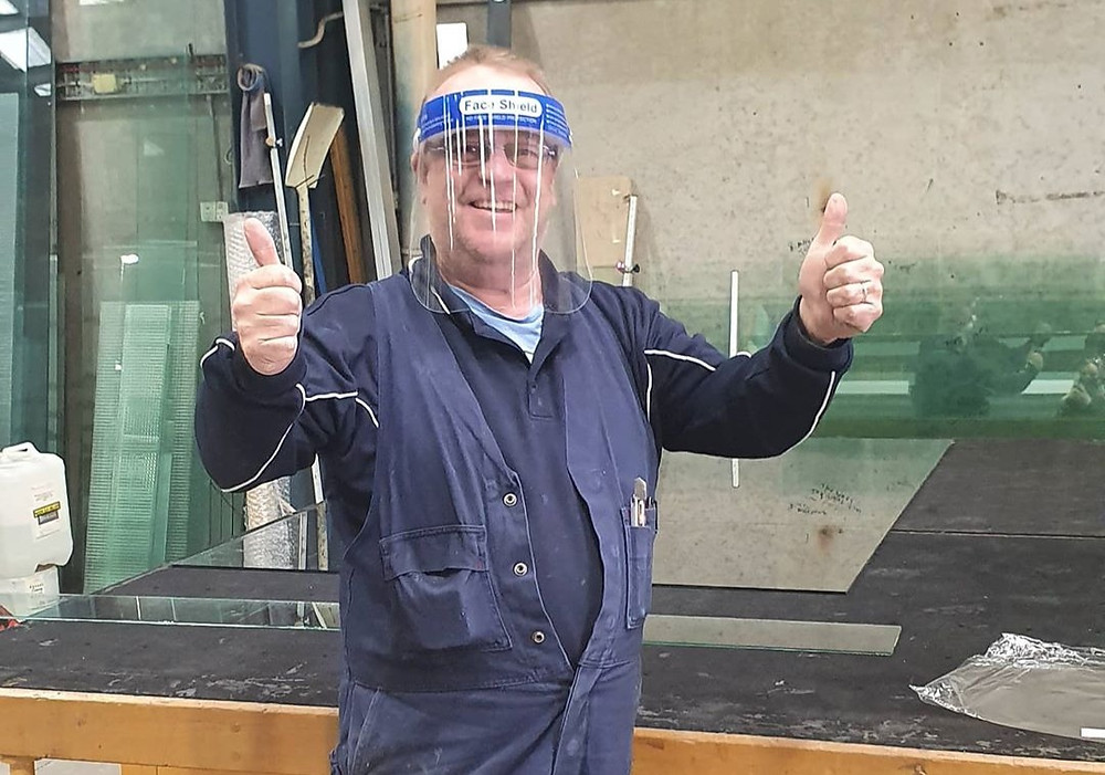 Tradie working on glass and steel fabrication