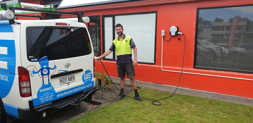 tradesperson and electrical van