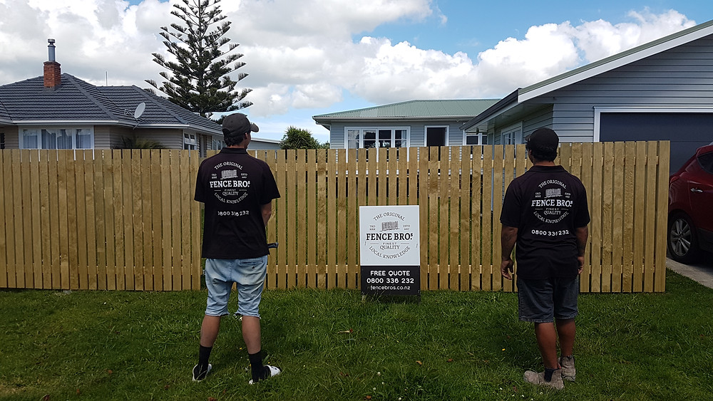 Fencing Bros team in front of finished fence