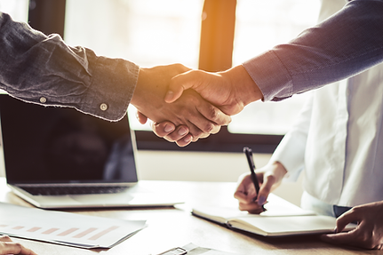 Office background with two people shaking hands