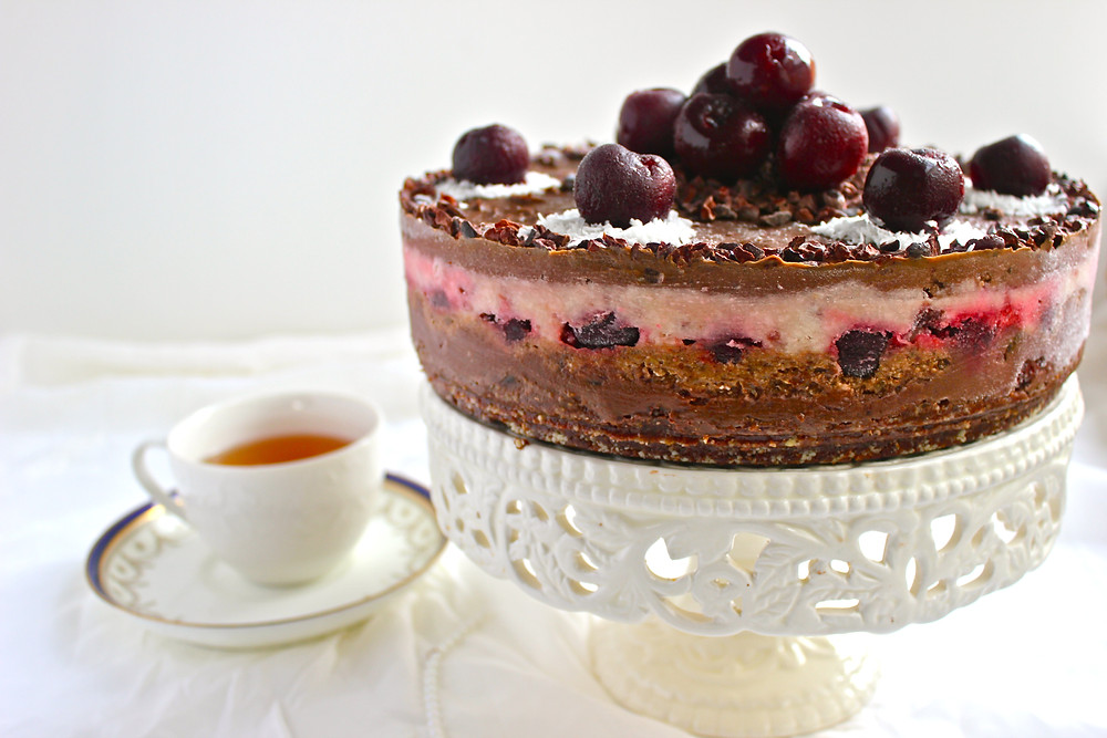 Why eat a Black Forest cake from the grocery made with refined oil, bleached flour and refined sugar when instead you could indulge your friends and loved ones with this whole foods, rich, 5-layer chocolate, coconut and cherry cake divine for any occasion?
