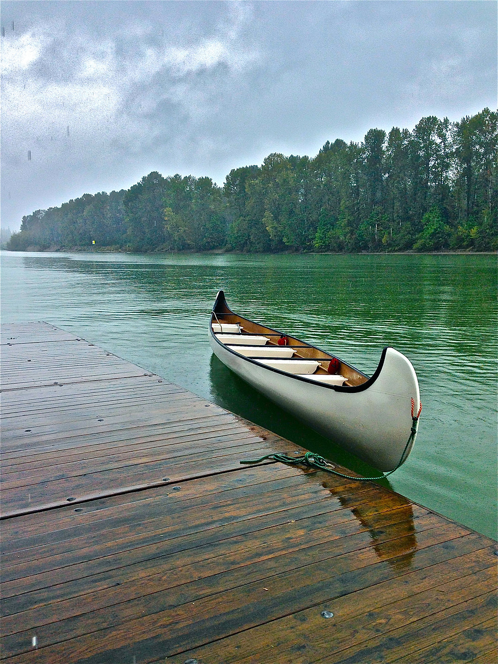 Canoeing in the rain, British Columbia, Canada.