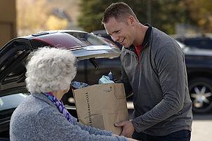 man-helping-elderly-woman-groceries_1176