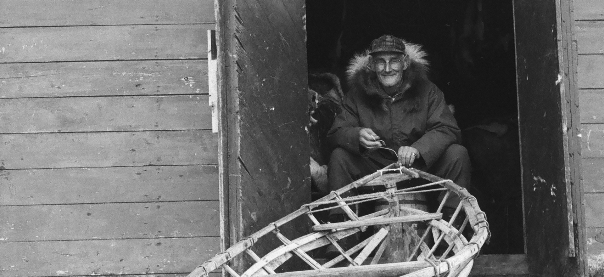 Kusiq Bodfish working on an umiaqaluraq in Wainwright, fall 1964.