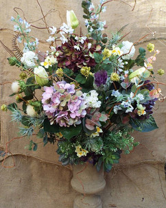 Faux flower and foliage arrangement.  Su
