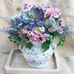 Faux flower and succulent arrangement.
