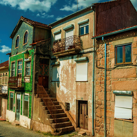 Canva - Old houses with worn facade and