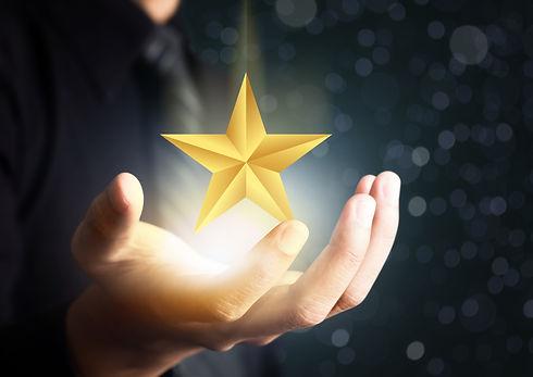 businessman holding excellence star.jpg