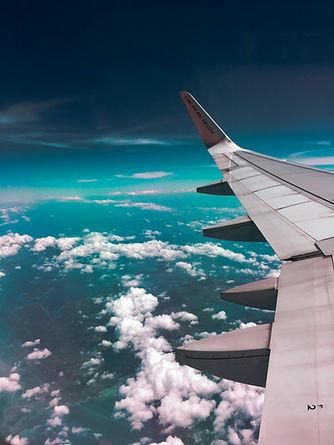 airplane-wing-towards-clouds-731217.jpg