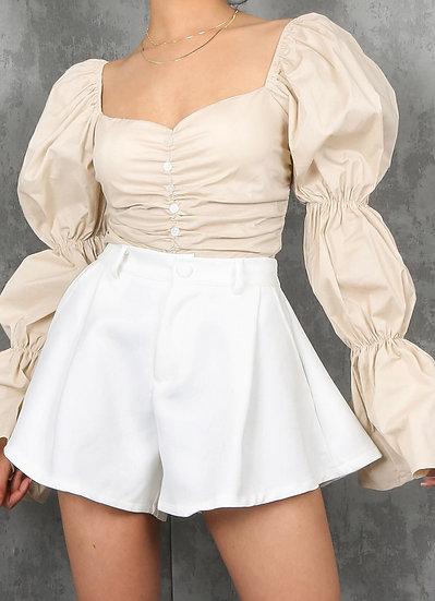 White flared shorts