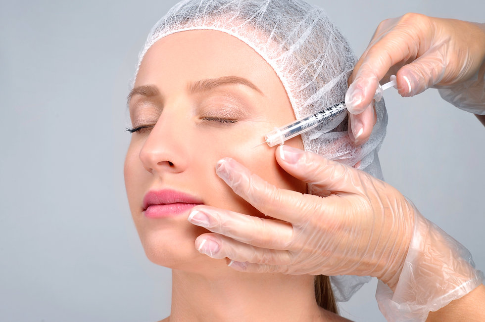 Woman is getting filler injection in che