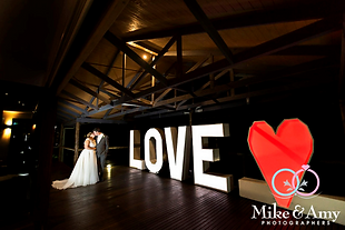 Giant 6ft Tall Light Up LOVE Letters and LOVE Heart inside a country hall at night wedding photo