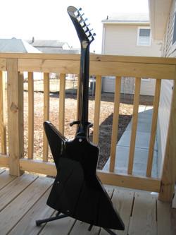 Set neck explorer guitar