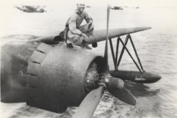 Dad on the propeller pontoon wing of the PBM5 seaplane that he crewed.