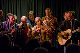 A group of musicans performing on stage.