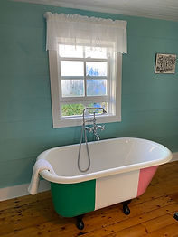 A large bath tub in front a window looking out into Francois.