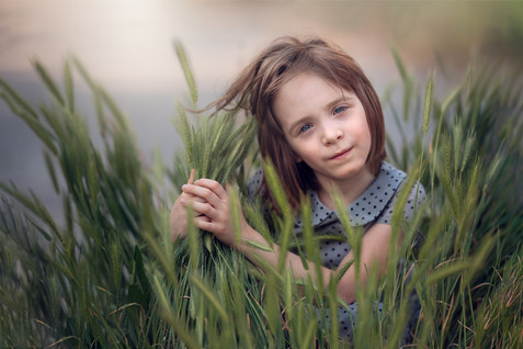 Spring portrait of girl in grass