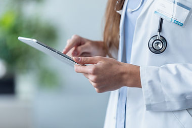 female-doctor-using-her-digital-tablet-i
