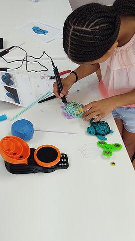 student making 3D pen art