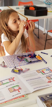 Young maker wokring on circuits at 5th Element Studios