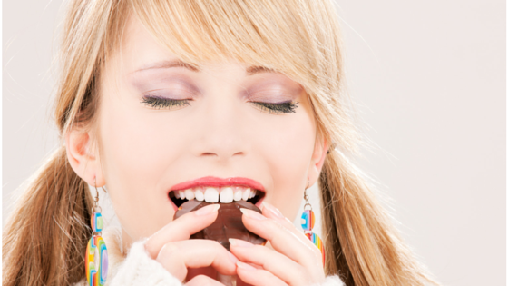 woman eating cookie.png