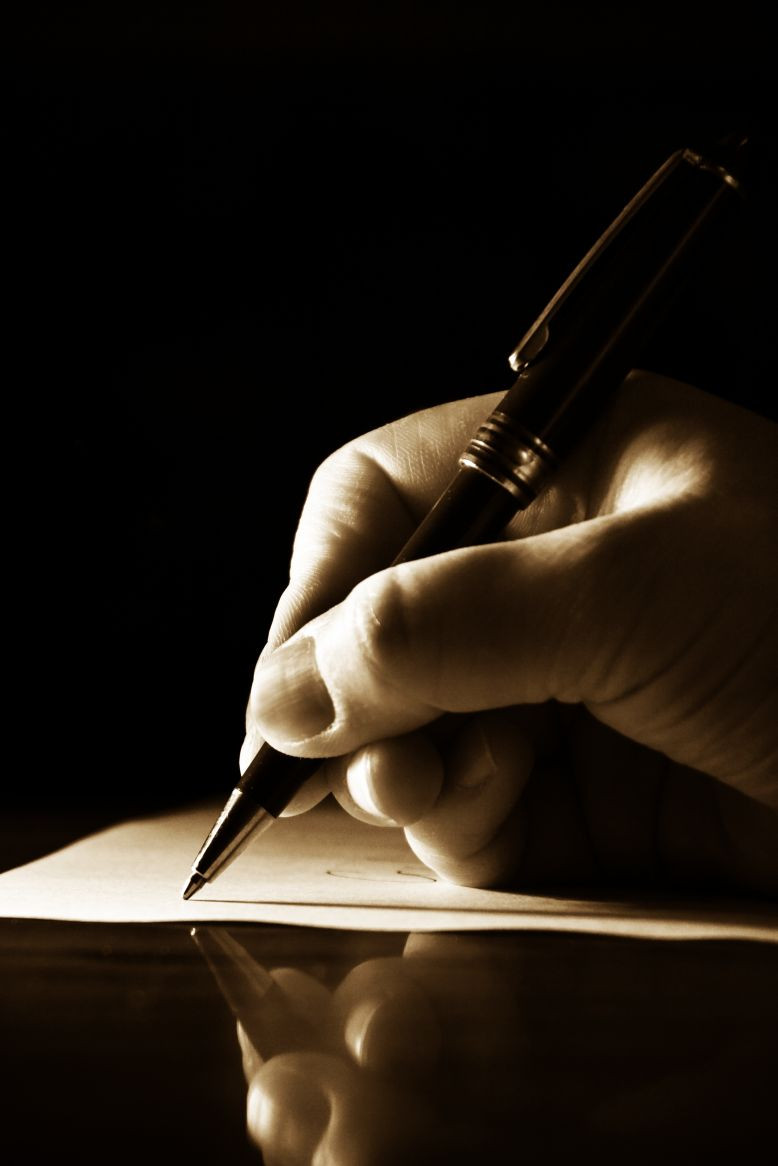 Hand-writing-on-paper-with-pen1.jpg