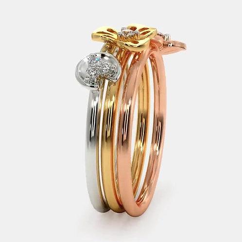 TRIO FLORAL, Trois Bagues sertie de Diamants en Or Blanc, Rose, Jaune 18 carats