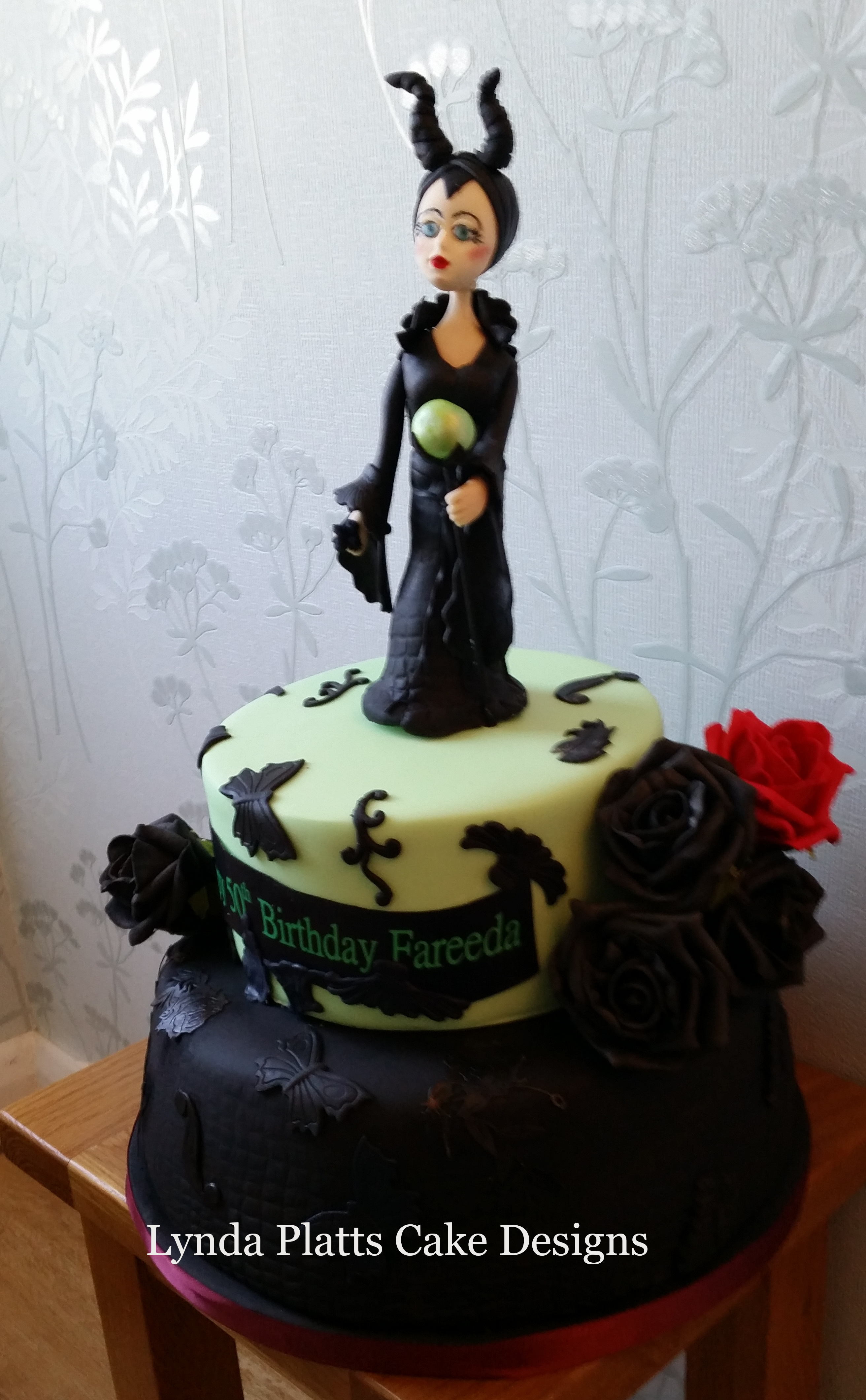 Malificent two tier celebration cake