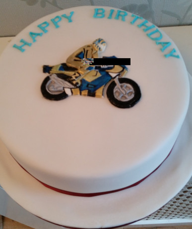 Motorbike cake in gold leathers.jpg