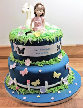 Pony and little girl two tier cake