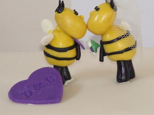 Kissing bee cake toppers