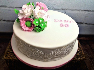 60th Birthday cake with edible lace side pannels and mixed bouquet of sugar flowers