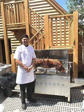 Chef - Chris Andrews with a perfectly cooked Free Range Hog