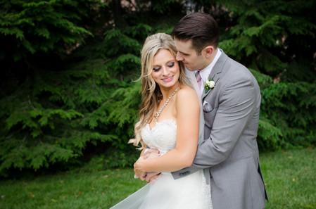 bride and groom hugging Dusquesne wedding