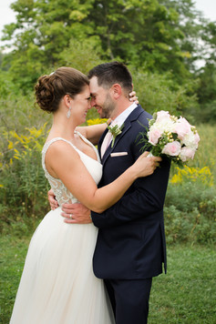 bride and groom touching heads smiling at Indian Lake in Irwin, PA