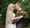 Bride and groom touching foreheads at the National Aviary in Pittsburgh, PA