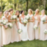 Bride and bridesmaids in light pink dresses laughing and smiling at Greenhouse Winery in Irwin, PA