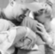 crying mom hugging new baby and dad right after birth at Westmorland Hospital in Greensburg, PA