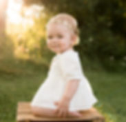 Adorable first birthday photo session in the fall with golden light and star headband