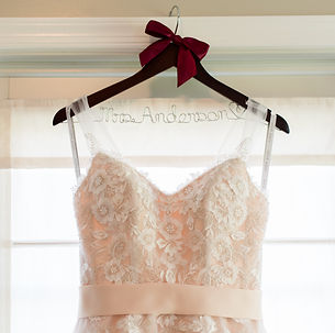 blush wedding gown on a pesonalized hanger
