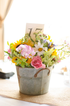 wedding center piece in a metal bucket