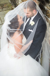 bride and groom veil picture at UPG wedding at Antonelli Event Center
