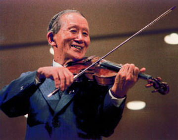 Dr Suzuki teaching his Suzuki violin method