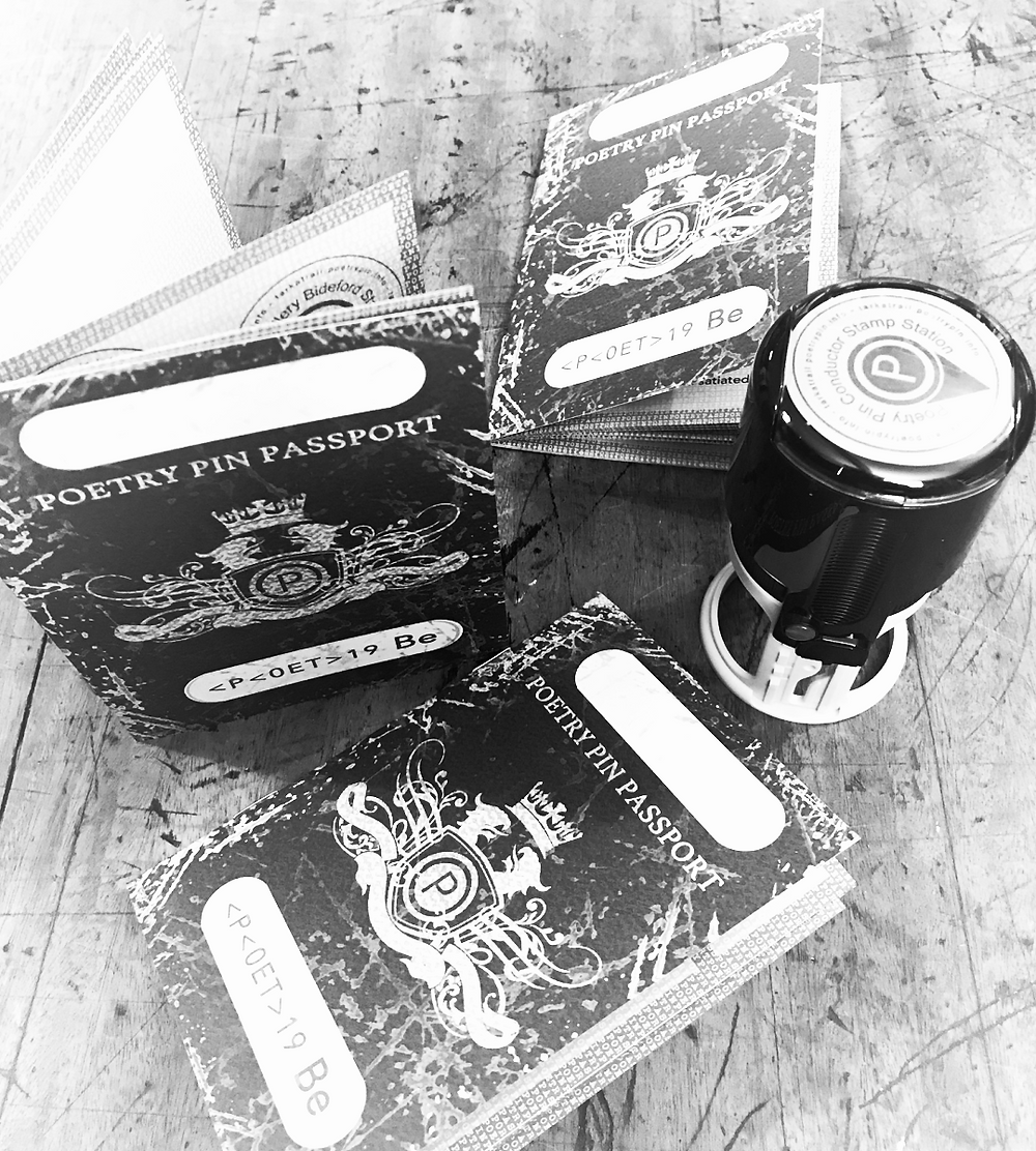 Poetry Passports and a Poetry Pin Stamp ready for its station.