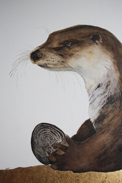 otter with labyrinth stone