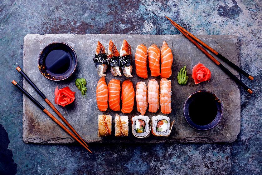 Sushi%2520Set%2520sashimi%2520and%2520sushi%2520rolls%2520served%2520on%2520stone%2520slate_edited_e