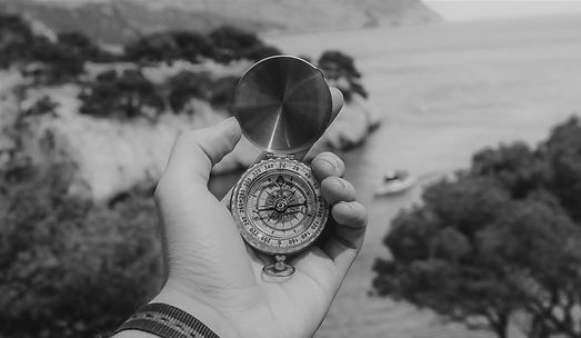 person-holding-compass-691637black and w