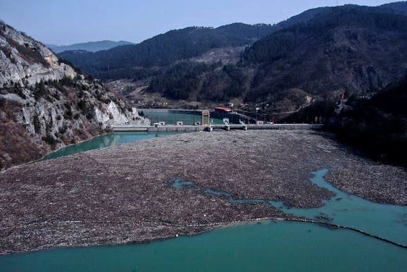 Trash fills Bosnia river faster than workers can pull it out
